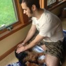 James shown doing Reiki on Rusty as part of his CIM treatment for an adrenal tumor
